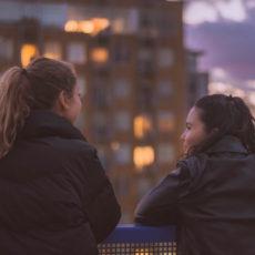 two teenagers talking