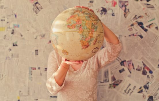 globe held in front of a person's face