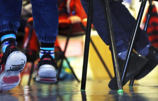 child's legs under a chair