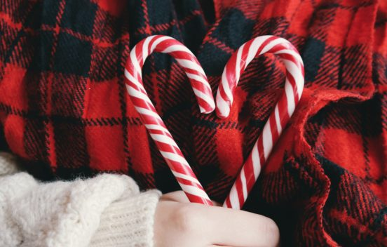 Christmas candy canes held in a heart shape