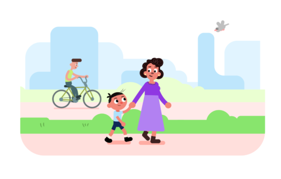 Animated still of a woman and boy walking hand in hand in a park.