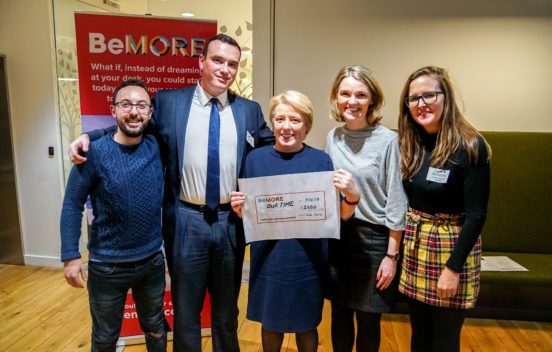 Dympna with the cohort of four young people from the BeMORE charity accepting a cheque from them