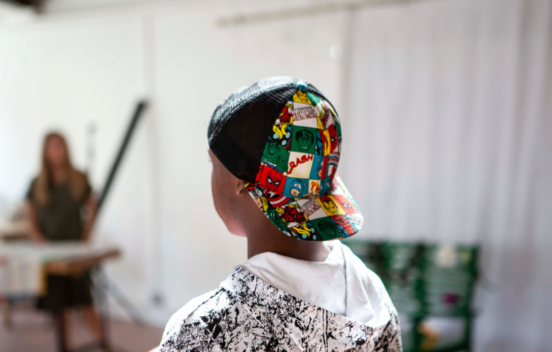 Back of the head of a boy wearing a colourful cap