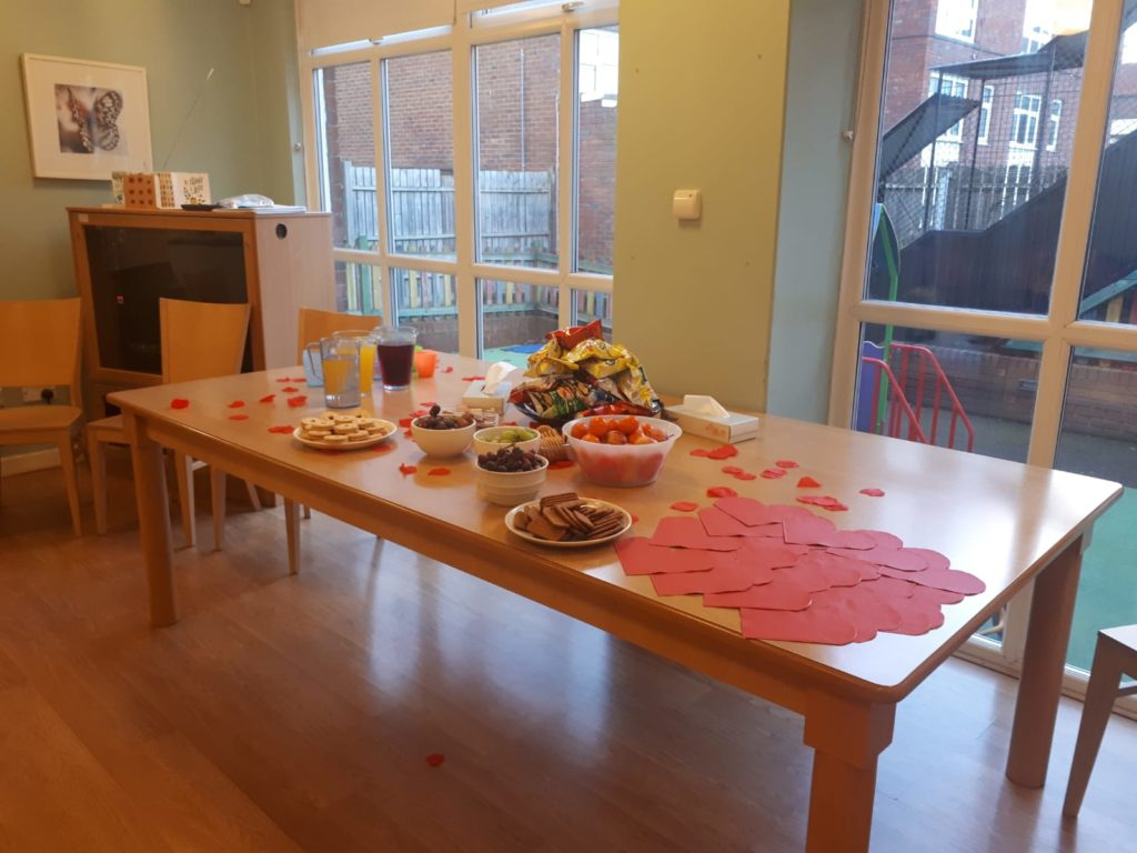 Table with food and activities on for the KidsTime Workshop