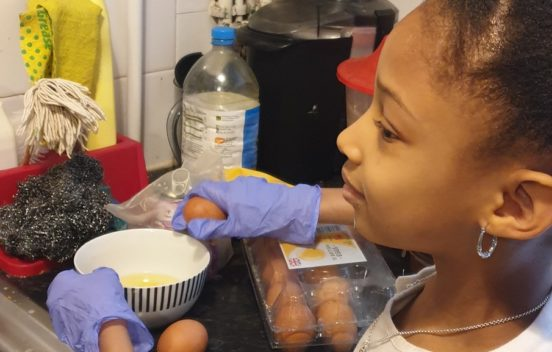 Image of a young girl baking a cake