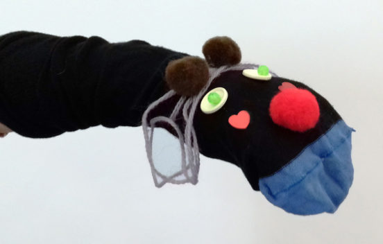 A photo of a wild looking sock puppet