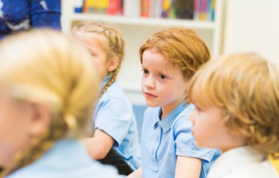 Group of school children listening