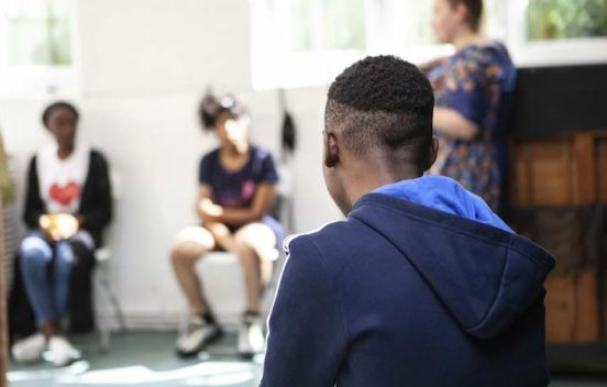 Back of boy's head at a workshop