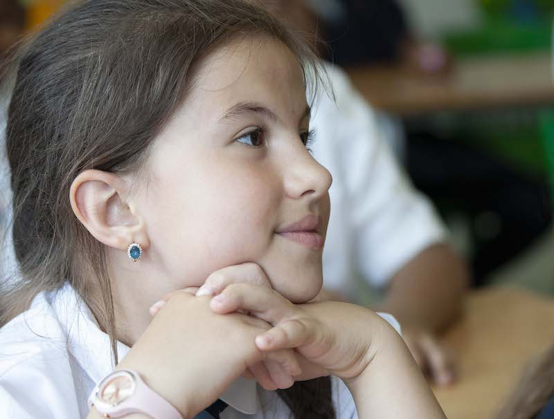 Pupil looking happy in class